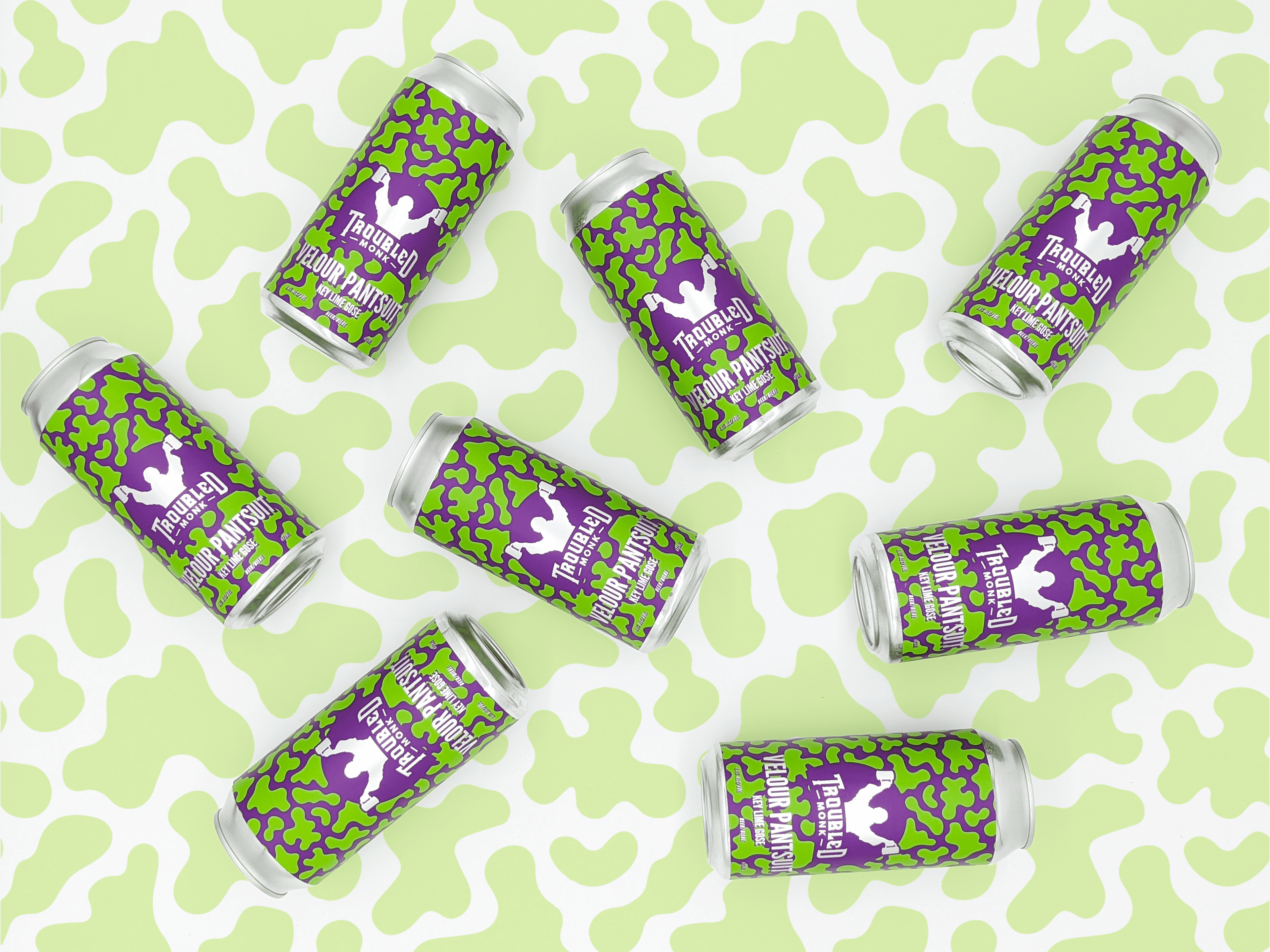 multiple green and purple cans of velour pantsuit key lime gose shot from above