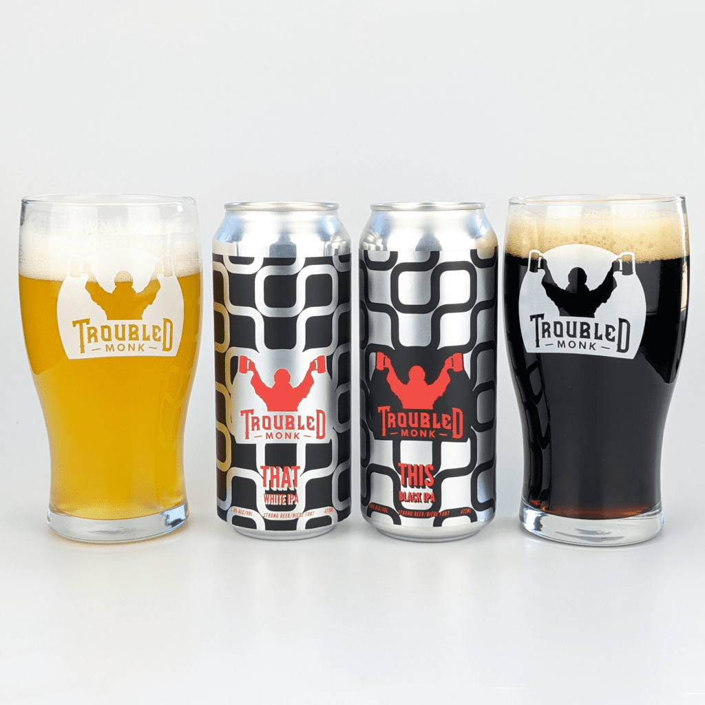 a picture of THAT White IPA poured into a glass with a golden straw colour, and a picture of THAT Black IPA poured into a glass appearing as a dark beer
