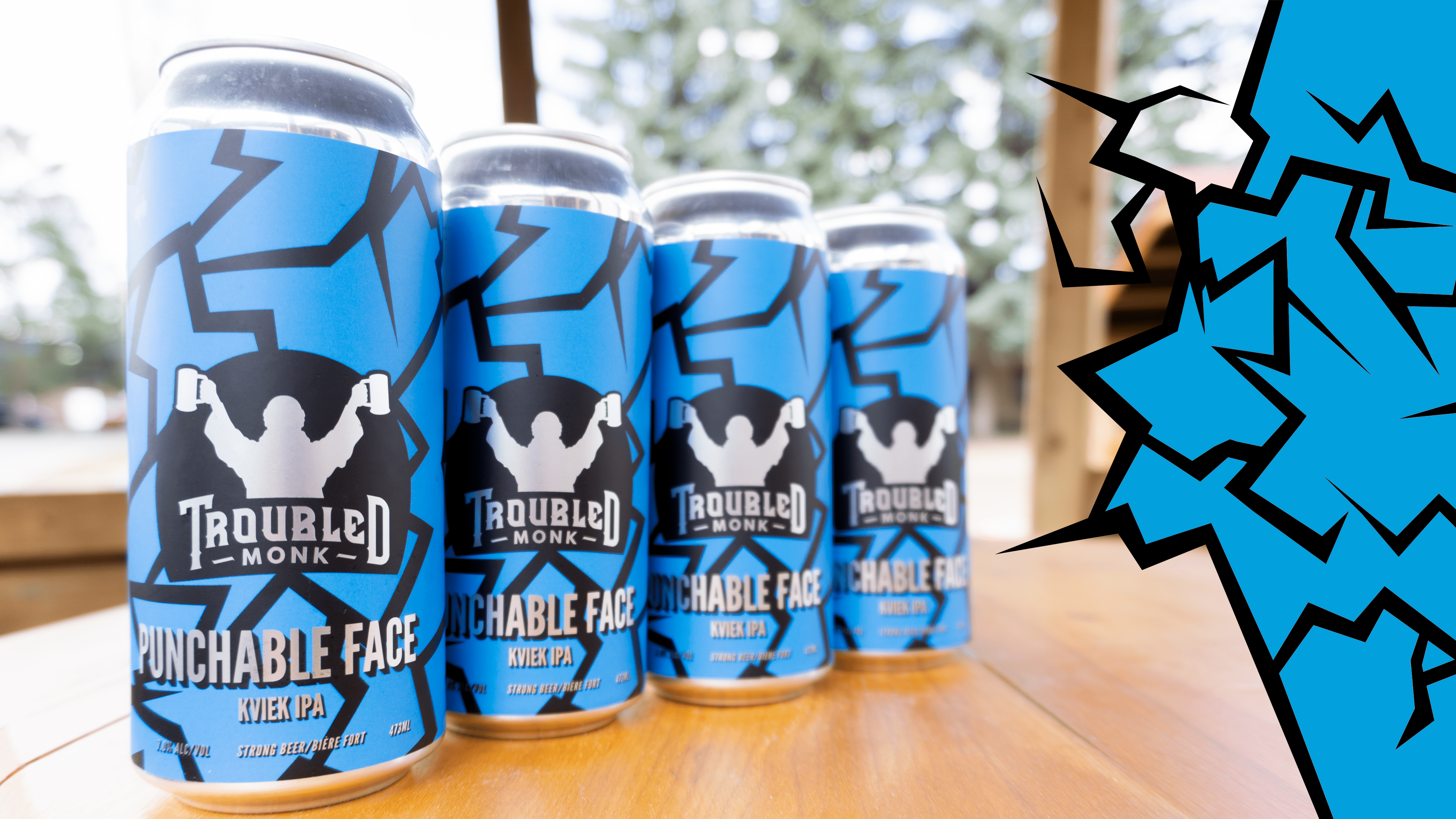 A line up of punchable face black and blue kviek ipa cans. Location is a cabana on troubled monk's patio.