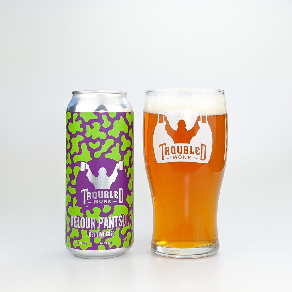 a picture of the green and purple velour pantsuit can and a picture of a pint of the amber coloured liquid