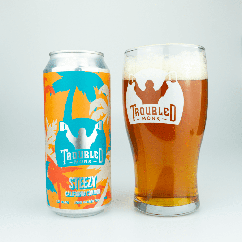 pour image of steezy california common poued into a pint glass with an amber colour