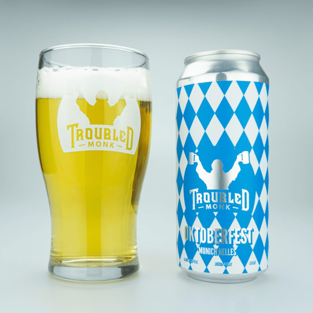 pour image of oktoberfest munich helles with a clear straw almost golden colour