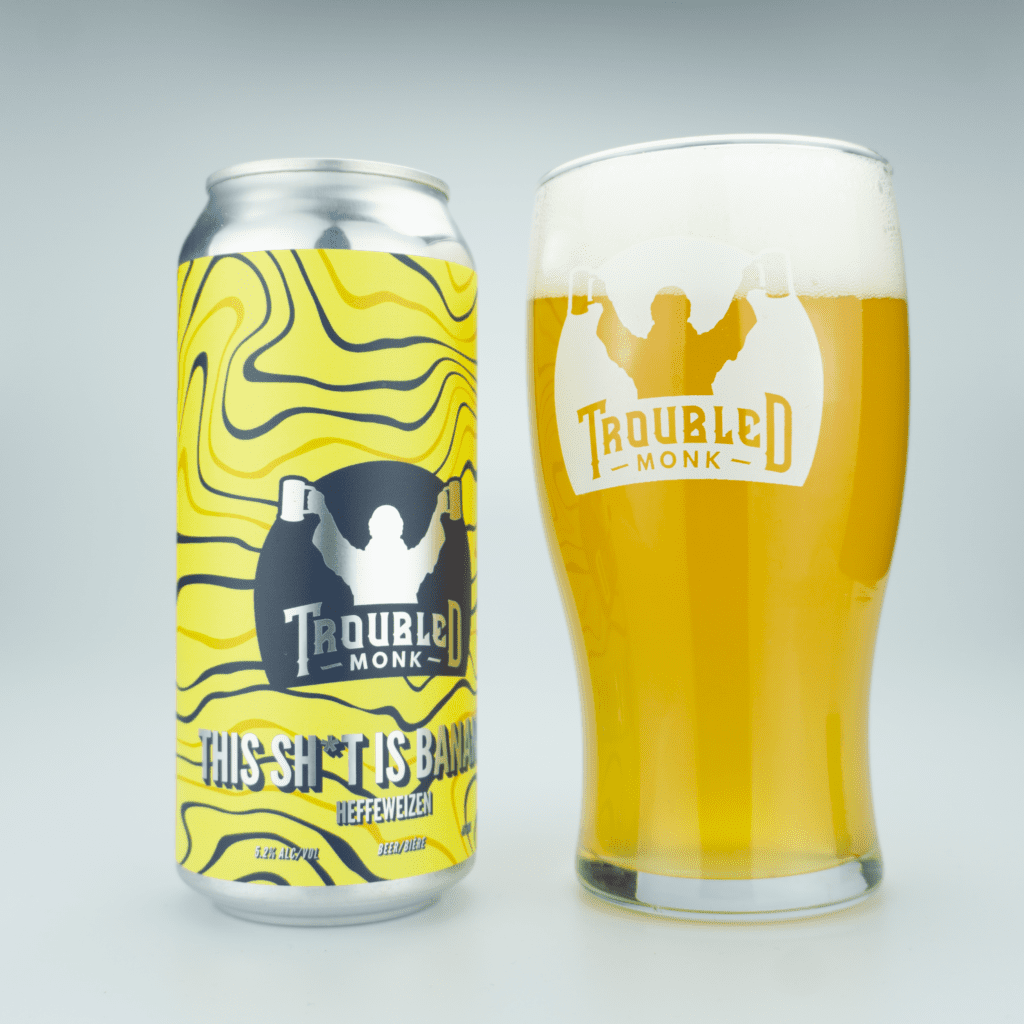 Picture of This Sh*t is Bananas can and poured pint of the hazy straw coloured liquid with a white head.